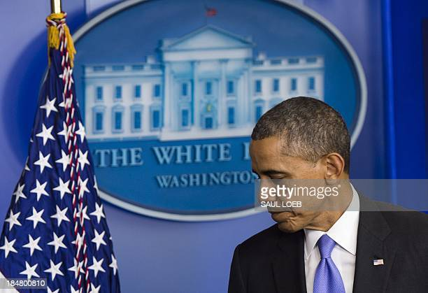 US President Barack Obama leaves after speaking about the government shutdown and debt ceiling standoff in the Brady Press Briefing Room of the White...