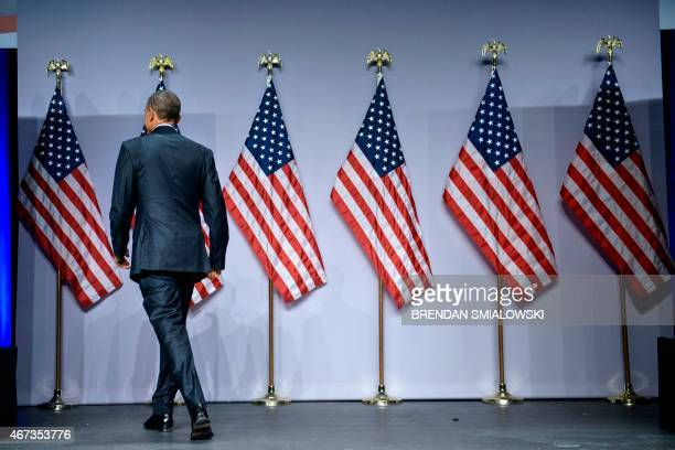 US President Barack Obama leaves after speaking during the SelectUSA Investment Summit at the Gaylord National Resort and Convention Center March 23...