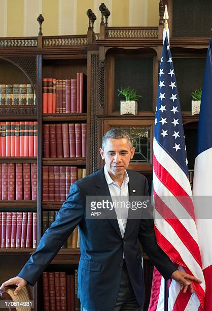 US President Barack Obama leaves at the end of a bilateral meeting with French President Francois Hollande on the sidelines of the G8 summit in the...