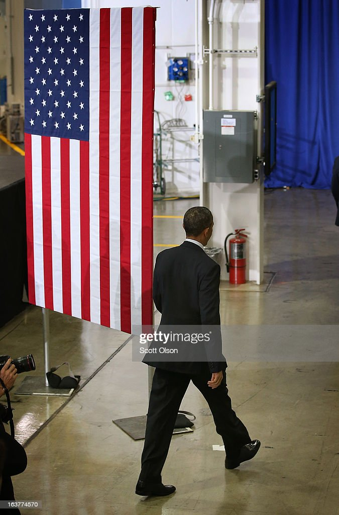 President <a gi-track='captionPersonalityLinkClicked' href=/galleries/search?phrase=Barack+Obama&family=editorial&specificpeople=203260 ng-click='$event.stopPropagation()'>Barack Obama</a> leaves following a speech at Argonne National Laboratory on March 15, 2013 in Argonne, Illinois. Obama used the event to push for more federally funded research into clean energy technologies. Argonne is the current home of a $120 million federal project to develop smaller, cheaper and more powerful batteries for electric vehicles.