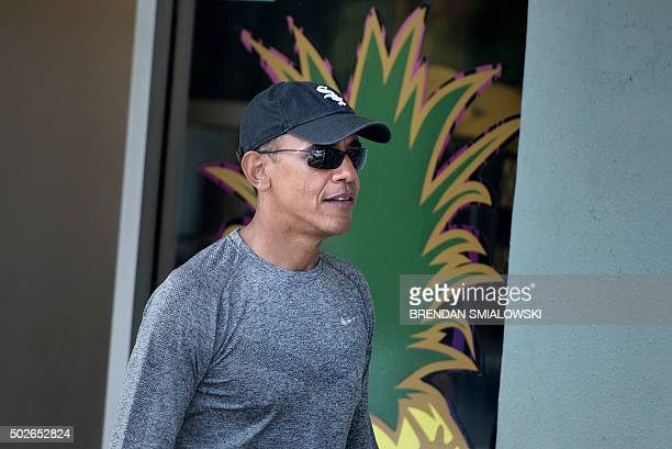 US President Barack Obama leaves Island Snow after eating shaved ice after a visit to the beach December 27 2015 in Kailua Hawaii Obama and the First...