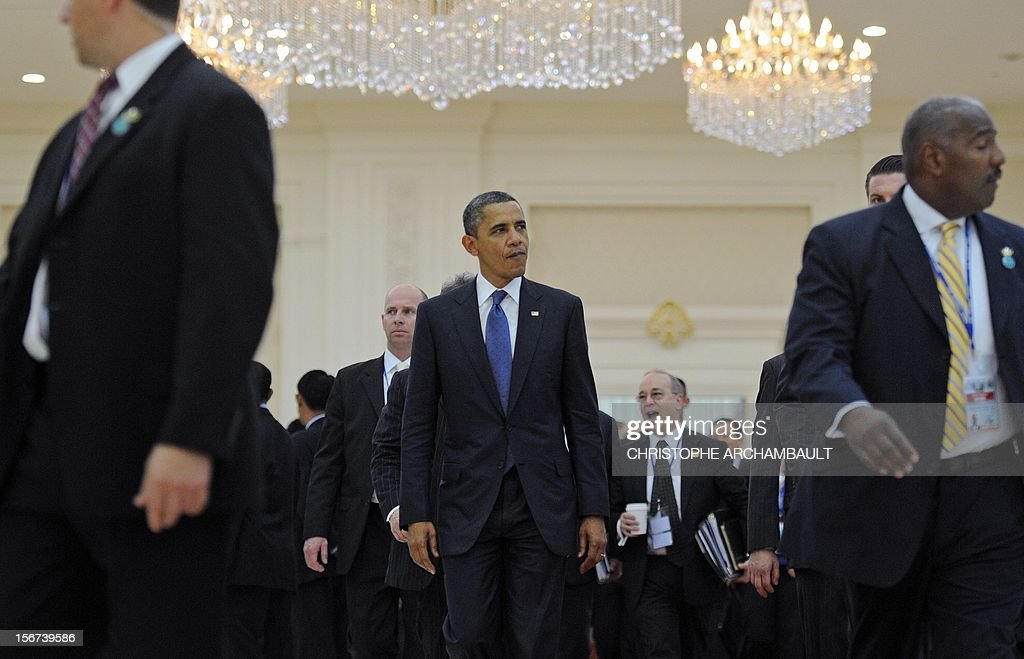 US President Barack Obama (C) leaves the 7th East Asia Summit in Phnom Penh on November 20, 2012. Obama was set to defy Beijing's protests and use a summit to raise concerns over South China Sea rows that have sent diplomatic and trade shockwaves across the region. AFP PHOTO/Christophe ARCHAMBAULT