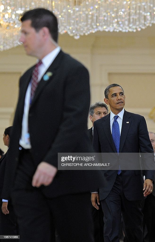 US President Barack Obama (R) leaves the 7th East Asia Summit in Phnom Penh on November 20, 2012. US President Barack Obama was set to defy Beijing's protests and use a summit to raise concerns over South China Sea rows that have sent diplomatic and trade shockwaves across the region. AFP PHOTO/Christophe ARCHAMBAULT