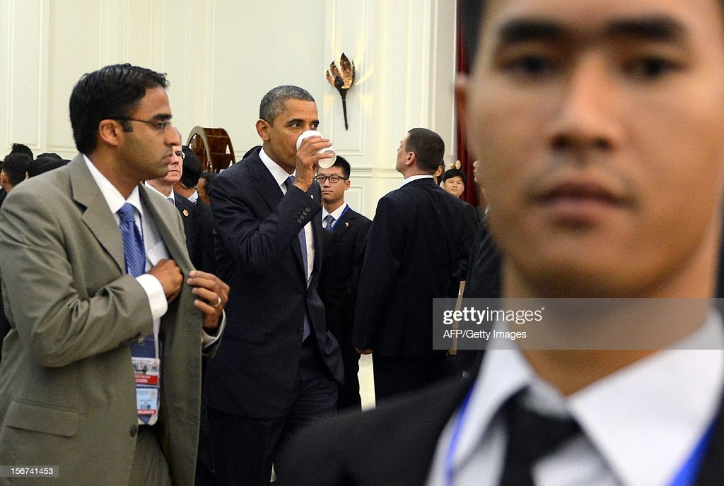 US President <a gi-track='captionPersonalityLinkClicked' href=/galleries/search?phrase=Barack+Obama&family=editorial&specificpeople=203260 ng-click='$event.stopPropagation()'>Barack Obama</a> (C) leaves the 7th East Asia Summit Plenary Session at the Peace Palace in Phnom Penh on November 20, 2012. Obama was on November 20, set to defy Beijing's protests and use a summit to raise concerns over South China Sea rows that have sent diplomatic and trade shockwaves across the region.