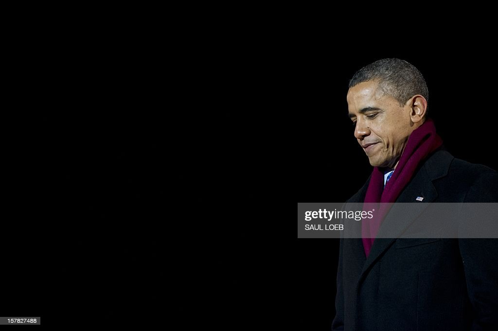 US President Barack Obama leaves the stage after speaking during the National Christmas Tree Lighting on the Ellipse adjacent to the White House in Washington, DC, on December 6, 2012. The annual event, hosted by Harris, features US President Barack Obama and performances by Jason Mraz, Ledisi, James Taylor, Kenny 'Babyface' Edmonds, Colbie Caillat and American Idol season 11 winner Phillip Phillips. AFP PHOTO / Saul LOEB