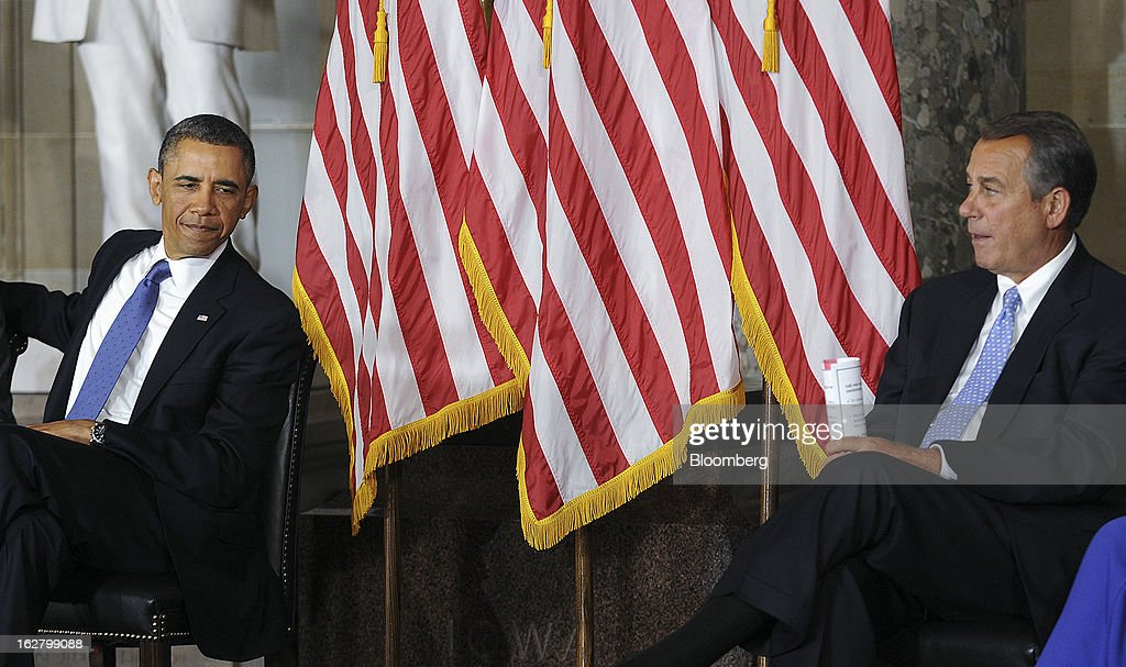 """U.S. President Barack Obama, left, and House Speaker John Boehner, a Republican from Ohio, listen during the unveiling of a statue of civil rights icon Rosa Parks at the Capitol in Washington, D.C., U.S., on Wednesday, Feb. 27, 2013. 'With the simplest of gestures, she helped change America and change the world,"""" Obama said at the ceremony. Photographer: Olivier Douliery/Pool via Bloomberg"""