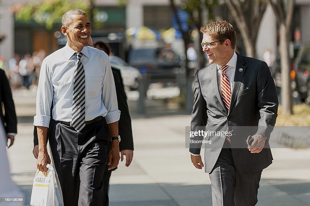 U.S. President Barack Obama, left, and Jay Carney, White House press secretary, walk back to the White House after picking up lunch at a Taylor Gourmet Deli location on Pennsylvania Avenue in Washington, D.C., U.S., on Friday, Oct. 4, 2013. Obama canceled plans to attend two economic summits in Asia next week, a setback for his top foreign policy goal, as he remains in Washington to seek an end to the partial government shutdown. Photographer: Pete Marovich/Bloomberg via Getty Images