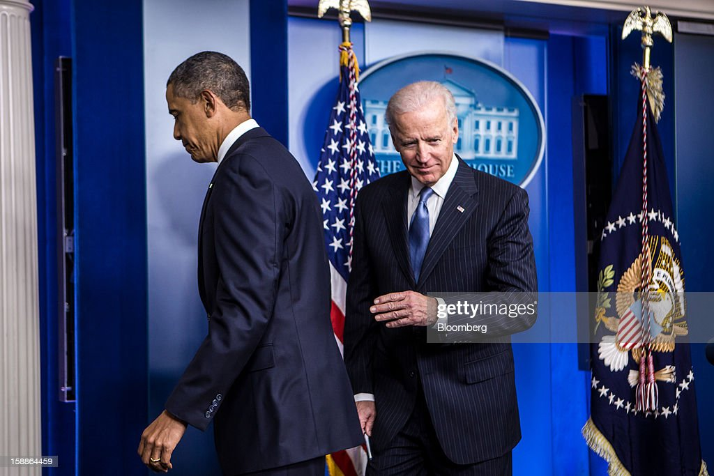 U.S. President Barack Obama, left, and U.S. Vice President Joseph 'Joe' Biden depart after speaking in the Brady Press Briefing Room at the White House in Washington, D.C., U.S., on Tuesday, Jan. 1, 2013. The House of Representatives passed legislation averting income tax increases for most U.S. workers after Republicans abandoned their effort to attach spending cuts that would have been rejected by the Senate. Photographer: Brendan Hoffman/Pool via Bloomberg