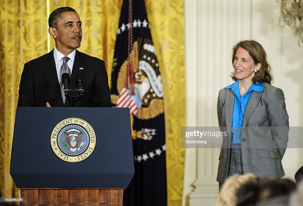 U.S. President Barack Obama, left, announces personnel nominations as Sylvia Mathews Burwell listens in the East Room of the White House in in Washington, D.C., U.S., on Monday, March 4, 2013. Obama announced three cabinet-level nominations, choosing Burwell of the Wal-Mart Foundation as director of the Office of Management and Budget, scientist Ernest Moniz as head of the Energy Department, and Gina McCarthy to lead the Environmental Protection Agency (EPA), where she's been an assistant administrator. Photographer: Pete Marovich/Bloomberg via Getty Images