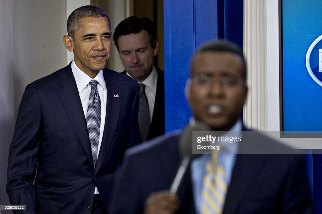 U.S. President Barack Obama, left, arrives to speak in the Brady Press Briefing Room of the White House in Washington, D.C., U.S., on Friday, May 6, 2016. The Labor Department on Friday said that U.S. employers added the fewest jobs in seven months in April amid subdued economic growth. Obama considers the economic recovery since he became president in 2009 to be the central achievement of his presidency. Photographer: Andrew Harrer/Bloomberg via Getty Images