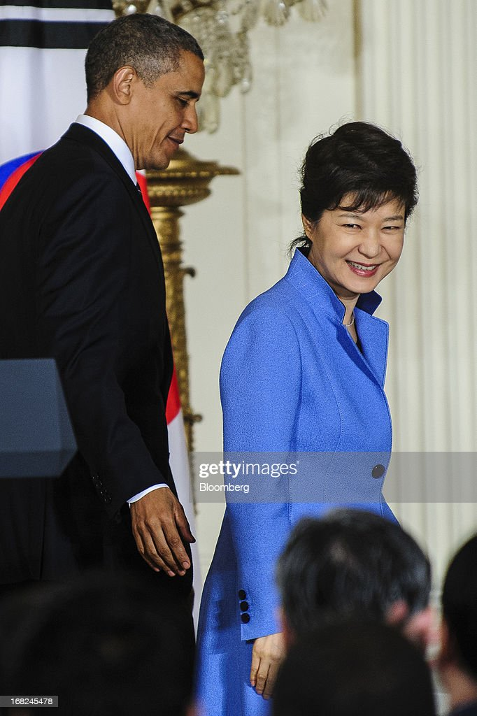 U.S. President <a gi-track='captionPersonalityLinkClicked' href=/galleries/search?phrase=Barack+Obama&family=editorial&specificpeople=203260 ng-click='$event.stopPropagation()'>Barack Obama</a>, left, exits with Park Geun Hye, president of South Korea, after a press conference in the East Room of the White House in Washington, D.C., U.S., on Tuesday, May 7, 2013. Obama and Park are seeking to demonstrate a solid front in the face of threats from North Korea and broader tensions in the region. Photographer: Pete Marovich/Bloomberg via Getty Images