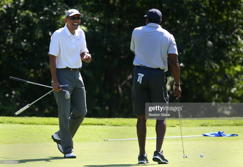 President Barack Obama, left, is all smiles as he approaches one of his golfing partners Ahmad Rashad, right, the former NFL player, while golfing at Farm Neck Golf club.