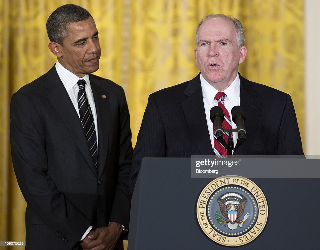 "U.S. President Barack Obama, left, listens as his nominee for director of the Central Intelligence Agency, John Brennan, White House chief counterterrorism adviser, speaks during an announcement in the East Room of the White House in Washington, D.C., U.S., on Monday, Jan. 7, 2013. ""Chuck Hagel is the leader that our troops deserve,"" Obama said today in an announcement combining his choices of Hagel for the Pentagon and Brennan to head the Central Intelligence Agency. Photographer: Joshua Roberts/Bloomberg via Getty Images"