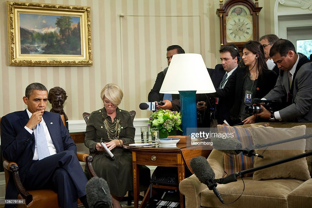 US President Barack Obama left listens to an interpretation of comments by Porfirio Lobo president of Honduras before a bilateral meeting in the Oval...