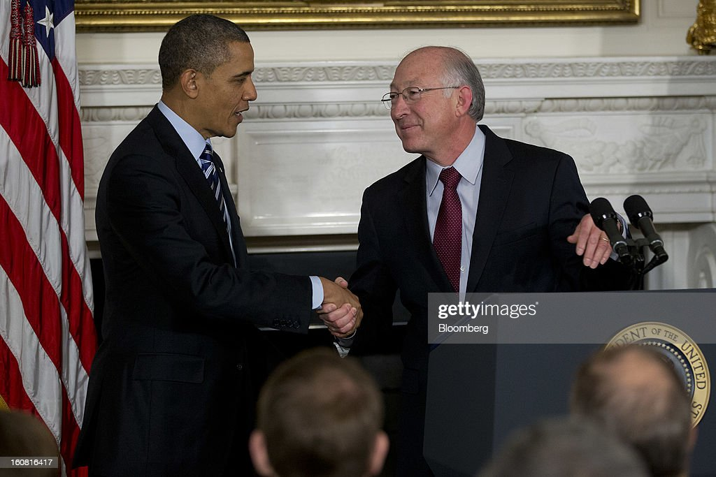 U.S. President <a gi-track='captionPersonalityLinkClicked' href=/galleries/search?phrase=Barack+Obama&family=editorial&specificpeople=203260 ng-click='$event.stopPropagation()'>Barack Obama</a>, left, shakes hands with <a gi-track='captionPersonalityLinkClicked' href=/galleries/search?phrase=Ken+Salazar&family=editorial&specificpeople=228558 ng-click='$event.stopPropagation()'>Ken Salazar</a>, U.S. secretary of the interior, during an announcement for Sally Jewell, chief executive officer of Recreational Equipment Inc., unseen, as a nominee to become secretary of the U.S. Interior Department at the White House in Washington, D.C., U.S., on Wednesday, Feb. 6, 2013. Jewell's background as an engineer and experience in the banking, energy and retail industries give her the skills needed to manage a department that oversees 500 million acres of public land, Obama said. Photographer: Andrew Harrer/Bloomberg via Getty Images