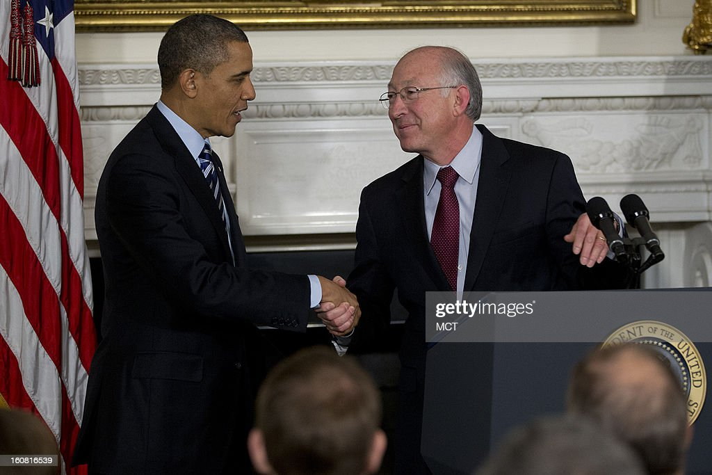 U.S. President Barack Obama, left, shakes hands with Ken Salazar, U.S. secretary of the interior, during an announcement for Sally Jewell, chief executive officer of Recreational Equipment Inc., unseen, as a nominee to become secretary of the U.S. Interior Department at the White House in Washington, D.C., on Wednesday, February 6, 2013.