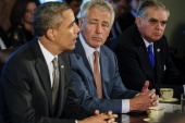 US President Barack Obama left speaks during a cabinet meeting with Chuck Hagel secretary of defense center and Ray LaHood secretary of...