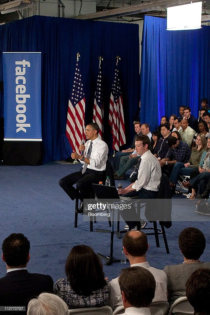 U.S. President <a gi-track='captionPersonalityLinkClicked' href=/galleries/search?phrase=Barack+Obama&family=editorial&specificpeople=203260 ng-click='$event.stopPropagation()'>Barack Obama</a>, left, speaks while <a gi-track='captionPersonalityLinkClicked' href=/galleries/search?phrase=Mark+Zuckerberg&family=editorial&specificpeople=4841191 ng-click='$event.stopPropagation()'>Mark Zuckerberg</a>, co-founder and chief executive officer of Facebook Inc., smiles during a town hall event at Facebook headquarters in Palo Alto, California, U.S., on Wednesday, April 20, 2011. Obama said members of both political parties in Washington need to work together to start reducing the nation's budget deficit in a 'balanced way.' Photographer: David Paul Morris/Bloomberg via Getty Images