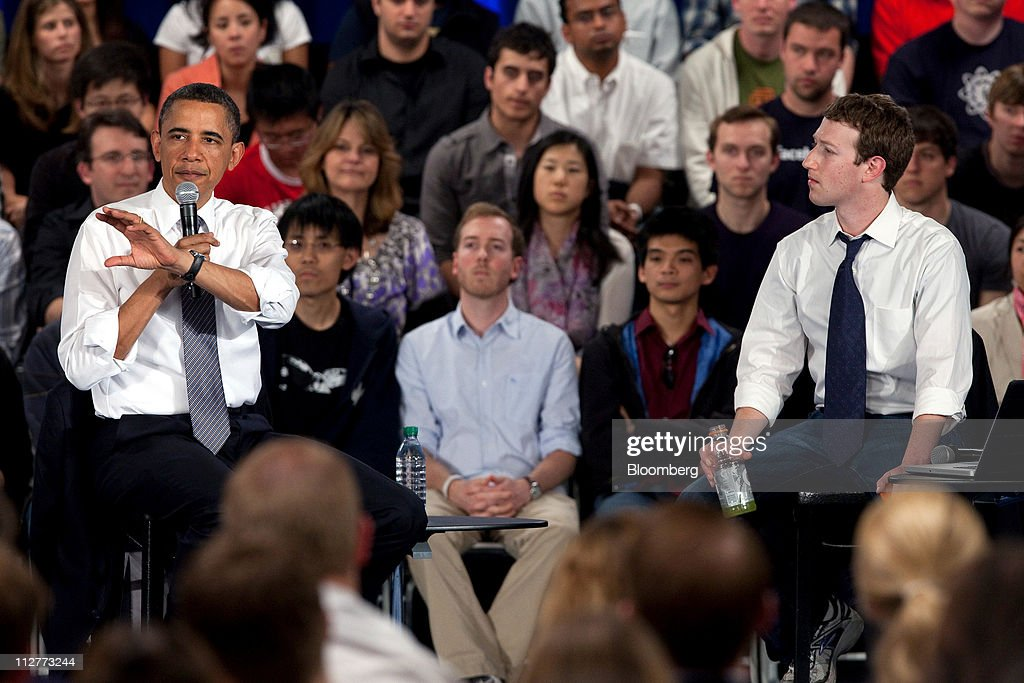 U.S. President <a gi-track='captionPersonalityLinkClicked' href=/galleries/search?phrase=Barack+Obama&family=editorial&specificpeople=203260 ng-click='$event.stopPropagation()'>Barack Obama</a>, left, speaks while <a gi-track='captionPersonalityLinkClicked' href=/galleries/search?phrase=Mark+Zuckerberg&family=editorial&specificpeople=4841191 ng-click='$event.stopPropagation()'>Mark Zuckerberg</a>, co-founder and chief executive officer of Facebook Inc., listens during a town hall event at Facebook headquarters in Palo Alto, California, U.S., on Wednesday, April 20, 2011. Obama said members of both political parties in Washington need to work together to start reducing the nation's budget deficit in a 'balanced way.' Photographer: David Paul Morris/Bloomberg via Getty Images