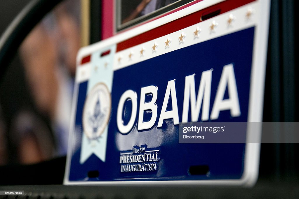 A U.S. President <a gi-track='captionPersonalityLinkClicked' href=/galleries/search?phrase=Barack+Obama&family=editorial&specificpeople=203260 ng-click='$event.stopPropagation()'>Barack Obama</a> license plate sits on display for sale at the Presidential Inaugural Committee store in Washington, D.C., U.S., on Friday, Jan. 18, 2013. President <a gi-track='captionPersonalityLinkClicked' href=/galleries/search?phrase=Barack+Obama&family=editorial&specificpeople=203260 ng-click='$event.stopPropagation()'>Barack Obama</a>'s second inauguration next week will combine the star power of Beyonce, Kelly Clarkson and James Taylor with a lineup that reflects social values Obama will champion in his new term. Photographer: Andrew Harrer/Bloomberg via Getty Images
