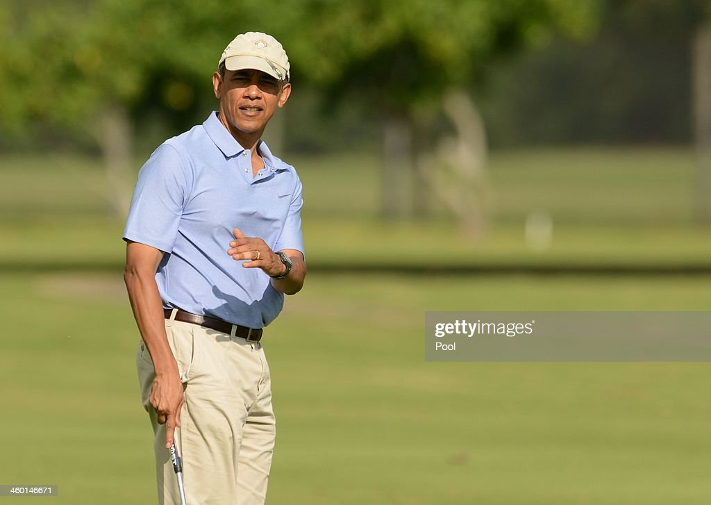 S President Barack Obama lines up his putt on the second green while golfing with the Prime MInister of New Zealand John Key at Marine Corps Base...