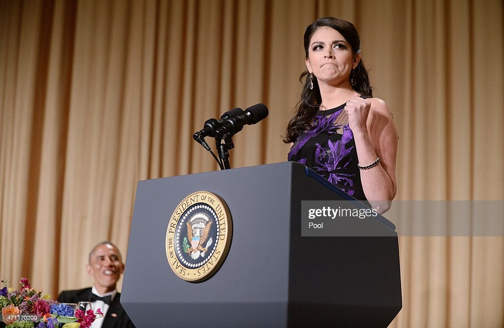 President Barack Obama listens as comedienne Cecily Strong of the Saturday Night Live show speaks at the annual White House Correspondent's Association Gala at the Washington Hilton hotel April 25, 2015 in Washington, D.C. The dinner is an annual event attended by journalists, politicians and celebrities.
