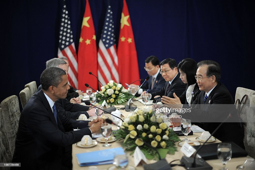 US President Barack Obama (L) listens as he holds a bilateral meeting with Chinese Premier Wen Jiabao (R) on the sidelines of the East Asian Summit at the Peace Palace in Phnom Penh on November 20, 2012. During the two-day East Asia Summit in Phnom Penh, Obama was scheduled to hold talks with the leaders of the 10-member Association of Southeast Asian Nations (ASEAN) along with Chinese Premier Wen Jiabao and Japan's Yoshihiko Noda. AFP PHOTO / Jewel Samad