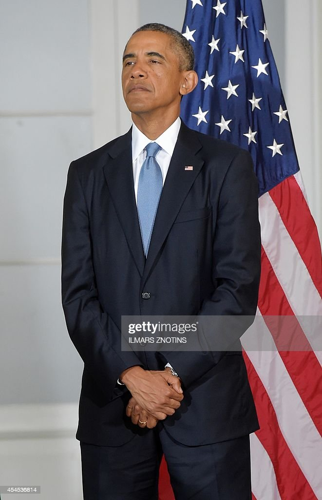 US President <a gi-track='captionPersonalityLinkClicked' href=/galleries/search?phrase=Barack+Obama&family=editorial&specificpeople=203260 ng-click='$event.stopPropagation()'>Barack Obama</a> listens as his Baltic counterparts deliver their statements after a multilateral meeting in Kadriorg Art Museum in Tallinn, Estonia, September 3, 2014. US President <a gi-track='captionPersonalityLinkClicked' href=/galleries/search?phrase=Barack+Obama&family=editorial&specificpeople=203260 ng-click='$event.stopPropagation()'>Barack Obama</a> underscored Washington's commitment to the security of NATO allies, announcing additional US planes to police the skies over Europe's eastern flank bordering Russia.
