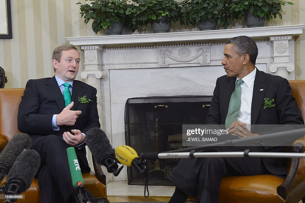 US President Barack Obama listens as Irish Prime Minister Enda Kenny makes remarks to reporters during a meeting in the Oval Office at the White House in Washington, DC, on March 19, 2013. The two leaders will be attending a luncheon on Capitol Hill later Tuesday. AFP PHOTO/Jewel Samad