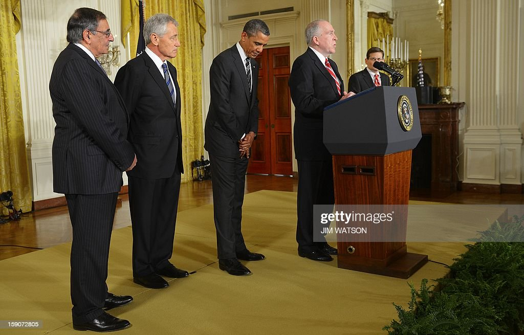 US President Barack Obama (C) listens as John Brennan (2nd R) speaks after being nominated for director of the Central Intelligence Agency (CIA)during an event with Chuck Hagel (2nd L), who was nominated as US Defense Secretary at the White House in Washington, DC, January 7, 2013. Also pictured are current US Defense Secretary Leon Panetta and Acting Director fo the CIA Michael Morell (R). AFP Photo/Jim WATSON