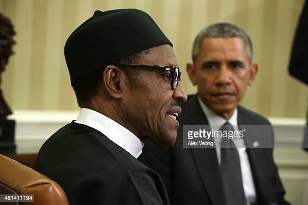 US President Barack Obama listens as Nigerian President Muhammadu Buhari speaks during a meeting in the Oval Office of the White House July 20 2015...
