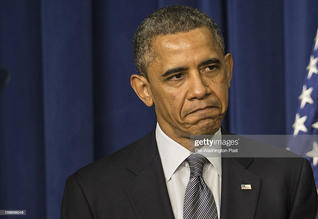 JANUARY 16 -- President Barack Obama listens as Vice-President Joe Biden, not shown, speaks at an event to unveil a package of proposals to reduce gun violence at the Eisenhower Executive Office Building in Washington, D.C., on Wednesday, January 16, 2013.
