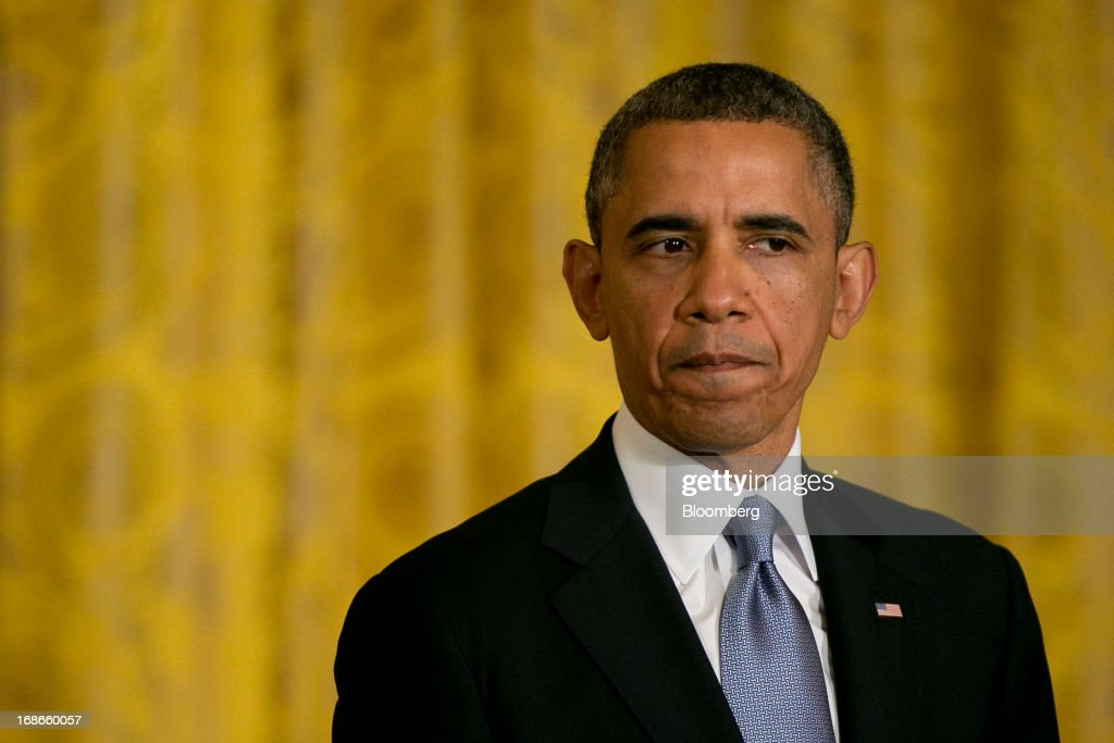 U.S. President <a gi-track='captionPersonalityLinkClicked' href=/galleries/search?phrase=Barack+Obama&family=editorial&specificpeople=203260 ng-click='$event.stopPropagation()'>Barack Obama</a> listens during a news conference with David Cameron, U.K. prime minister, not pictured, in the East Room of the White House in Washington, D.C., U.S., on Monday, May 13, 2013. President <a gi-track='captionPersonalityLinkClicked' href=/galleries/search?phrase=Barack+Obama&family=editorial&specificpeople=203260 ng-click='$event.stopPropagation()'>Barack Obama</a> said his administration made no attempt to cover up or downplay the involvement of terrorists in last year's deadly attack on a U.S. outpost in Benghazi, Libya, and said the congressional investigation has turned into a 'political circus.' Photographer: Andrew Harrer/Bloomberg via Getty Images