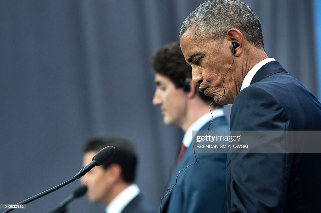 US President Barack Obama listens during a press conference at the North American Leaders Summit at the National Gallery of Canada June 29, 2016 in Ottawa, Ontario. / AFP / Brendan Smialowski
