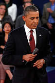 S President Barack Obama listens during a town hall style debate at Hofstra University October 16 2012 in Hempstead New York During the second of...