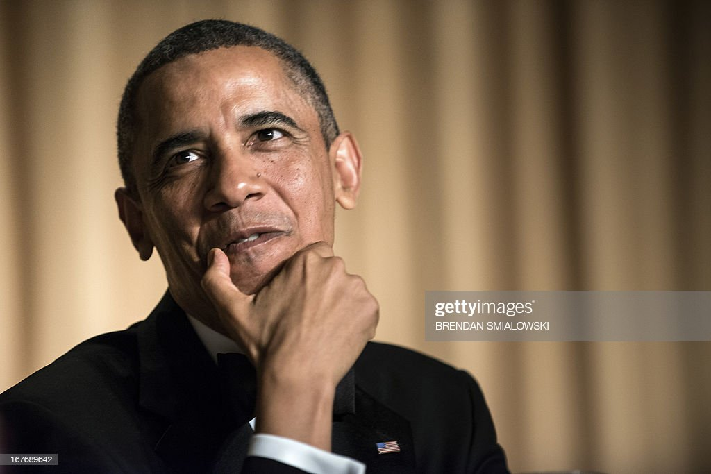 US President Barack Obama listens during the White House Correspondents' Association Dinner April 27, 2013 in Washington, DC. Obama attended the yearly dinner which is attended by journalists, celebrities and politicians. AFP PHOTO/Brendan SMIALOWSKI