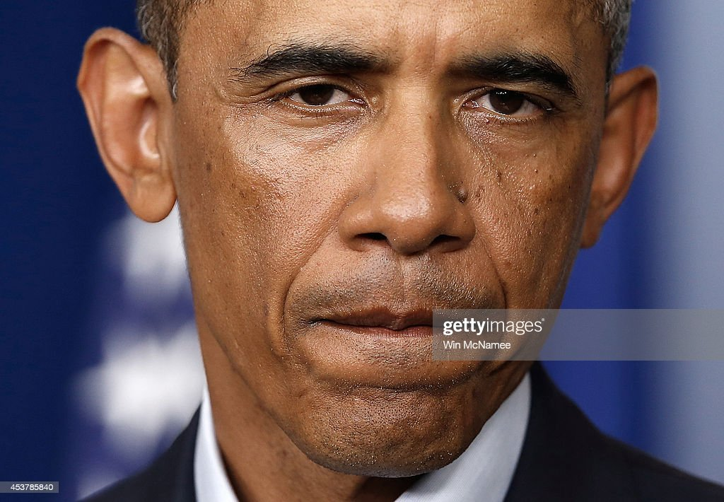 U.S. President <a gi-track='captionPersonalityLinkClicked' href=/galleries/search?phrase=Barack+Obama&family=editorial&specificpeople=203260 ng-click='$event.stopPropagation()'>Barack Obama</a> listens to a quesion at a press conference after delivering a statement in the Brady Press Briefing Room of the White House on August 18, 2014 in Washington, DC. Obama returned early from his vacation in Martha's Vineyard to hold meetings with his national security team and also with U.S. Attorney General Eric Holder in regards to the situation in Iraq and the continuing violence in Ferguson, Missouri.