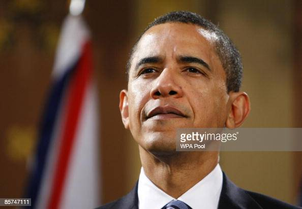 President Barack Obama listens to a question during a joint news conference with Britain's Prime Minister Gordon Brown and at the Foreign and...