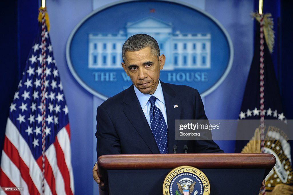 "U.S. President <a gi-track='captionPersonalityLinkClicked' href=/galleries/search?phrase=Barack+Obama&family=editorial&specificpeople=203260 ng-click='$event.stopPropagation()'>Barack Obama</a> listens to a question from the media in the Brady Press Briefing Room at the White House in Washington, D.C., U.S., on Friday, March 1, 2013. Obama said the automatic spending cuts set to kick in today will be a ""slow grind"" on the economy and that it may take weeks to win over enough lawmakers from both parties to reach a deal on a replacement deficit-cutting plan. Photographer: Pete Marovich/Bloomberg via Getty Images"