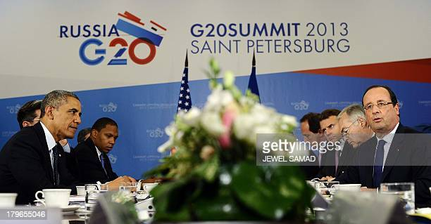 US President Barack Obama listens to Frances President Francois Hollande during a bilateral meeting in Saint Petersburg on September 6 2013 on the...
