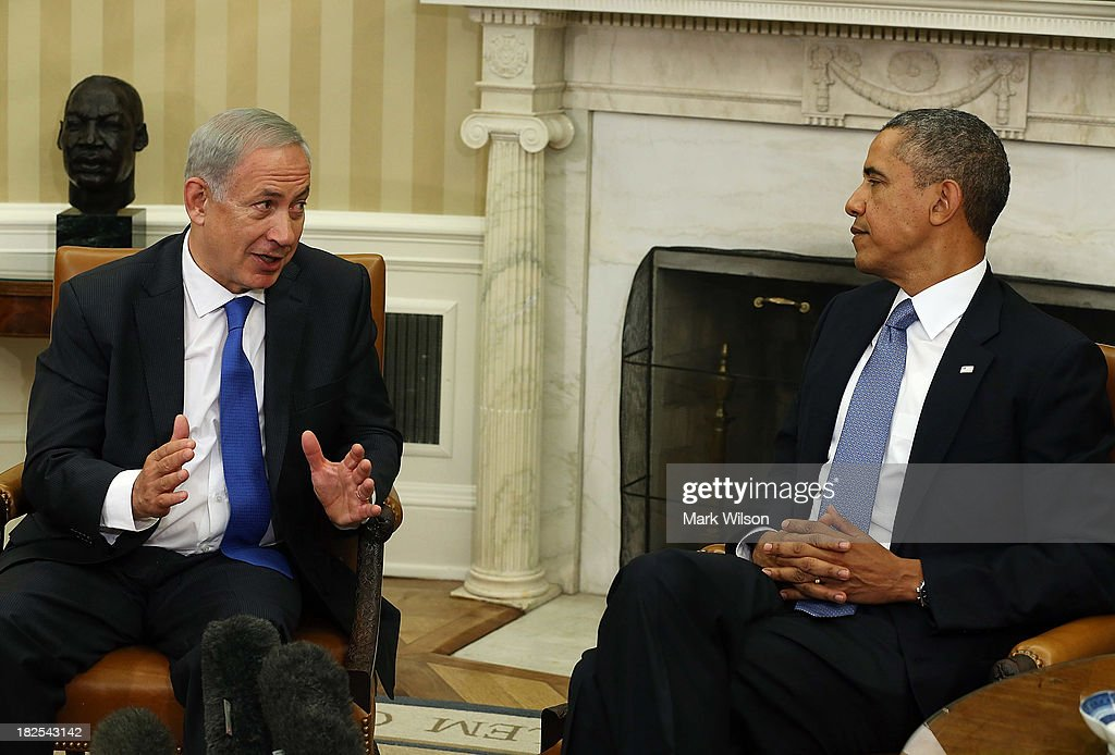 S President Barack Obama listens to Israeli President Benjamin Netanyahu speak during a meeting in the Oval Office September 30 2013 in Washington DC...