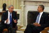 S President Barack Obama listens to Israeli President Benjamin Netanyahu speak during a meeting in the Oval Office September 30 2013 in Washington DC...