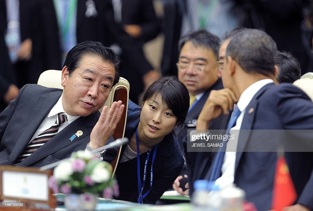 US President Barack Obama (R) listens to Japanese Prime Minister Yoshihiko Noda (L) as they attend an East Asian Summit Plenary Session at the Peace Palace in Phnom Penh on November 20, 2012. US President Barack Obama was set to dive into the tumultuous diplomatic waters of the South China Sea at a summit dominated by rival claims to the strategically vital area. AFP PHOTO/Jewel Samad