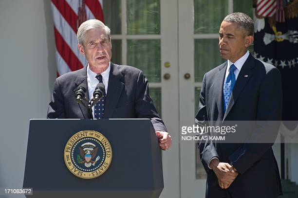 US President Barack Obama listens to outgoing FBI director Robert Mueller as Obama nominates Jim Comey to be the next director of the Federal Bureau...