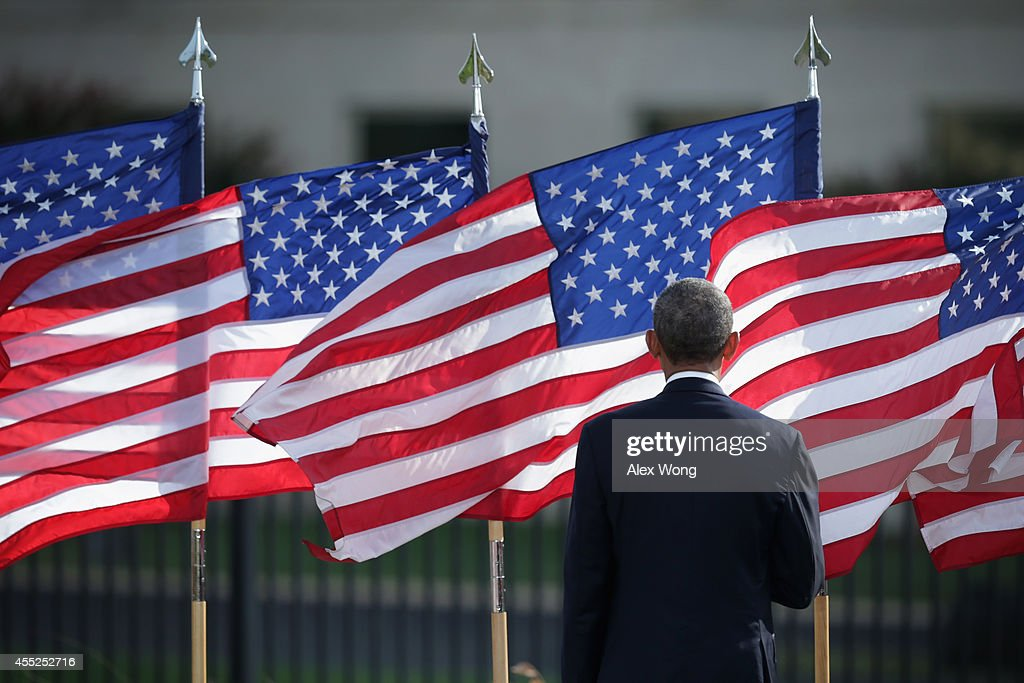 U.S. President <a gi-track='captionPersonalityLinkClicked' href=/galleries/search?phrase=Barack+Obama&family=editorial&specificpeople=203260 ng-click='$event.stopPropagation()'>Barack Obama</a> listens to the national anthem during a ceremony to mark the 13th anniversary of the 9/11 terrorists attacks at the Pentagon Memorial September 11, 2014 in front of the Pentagon in Arlington, Virginia. This year marks the 13th anniversary of the September 11th terrorist attacks that killed nearly 3,000 people at the World Trade Center, Pentagon and on Flight 93..
