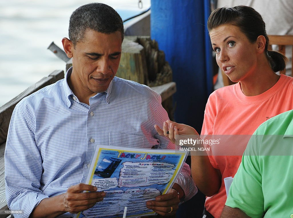 US President Barack Obama looks at a menu as chats with a waitress takes his order at Tacky Jacks Bar and Grill June 14, 2010 in Orange Beach, Alabama. Obama vowed to protect the way of life of residents in the oil-hit Gulf of Mexico region, as the US government ramped up efforts to ensure seafood is safe to eat. AFP PHOTO/Mandel NGAN
