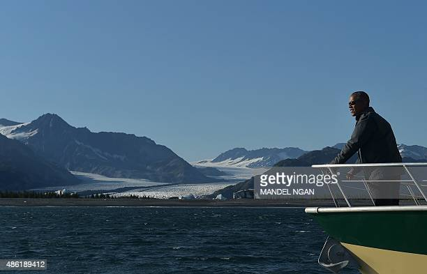 US President Barack Obama looks at Bear Glacier during a boat tour of the Kenai Fjords National Park on September 1 2015 in Seward Alaska Bear...
