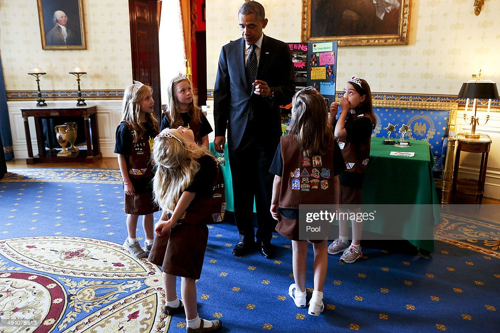 U.S. President Barack Obama looks at the 'flood-proof' bridge design project from Avery Dodson, Natalie Hurley, Miriam Schaffer, Claire Winton and Lucy Claire Sharp from Tusla. Oklahoma, winners of the Junior FIRST Lego League Challenge, during the 2014 White House Science Fair at the White House May 27, 2014 in Washington DC. The fair celebrates the winners of STEM (science, technology, engineering and math) competitions across the country.