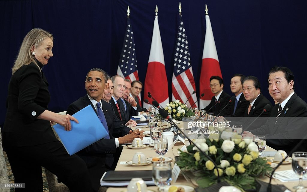 US President Barack Obama (2nd L) looks at US Secretary of State Hillary Clinton (L) before the start of a bilateral meeting with Japanese Prime Minister Yoshihiko Noda (R) on the sidelines of the East Asian Summit at the Peace Palace in Phnom Penh on November 20, 2012. During the two-day East Asia Summit in Phnom Penh, Obama was scheduled to hold talks with the leaders of the 10-member Association of Southeast Asian Nations (ASEAN) along with Chinese Premier Wen Jiabao and Japan's Yoshihiko Noda. AFP PHOTO / Jewel Samad