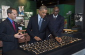 US President Barack Obama looks at World Series Championship rings as he tours the National Baseball Hall of Fame and Museum alongside former player...